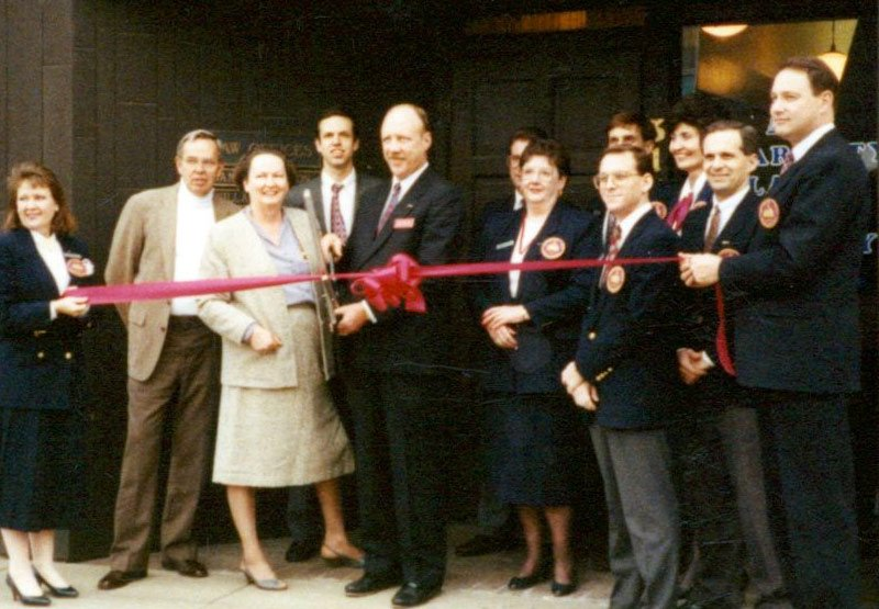 From 2nd left, Buz, Sandra, and Michael Holden, Michael Dalton, 1993 Ribbon cutting for Jefferson City, MO